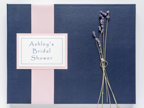 Navy Wedding Shower Guest & Memory Book with pink flat lay ribbon and plaque staged with flowers