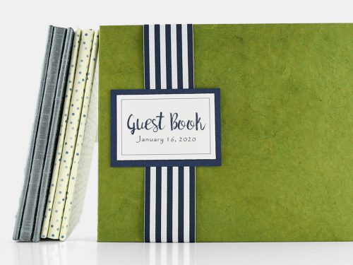 Guest Book with Olive Cover and Navy and white striped flat lay ribbon under a navy and white guest book plaque