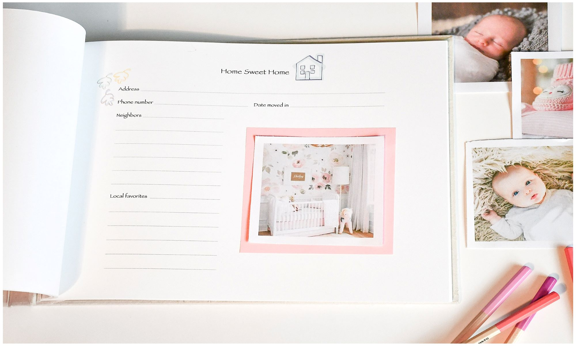 Pink cloth cover baby memory book with open page and photos