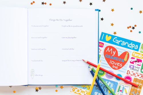 Blue I Love You Grandfather Kids Journal with open page, colored pencils, and stickers