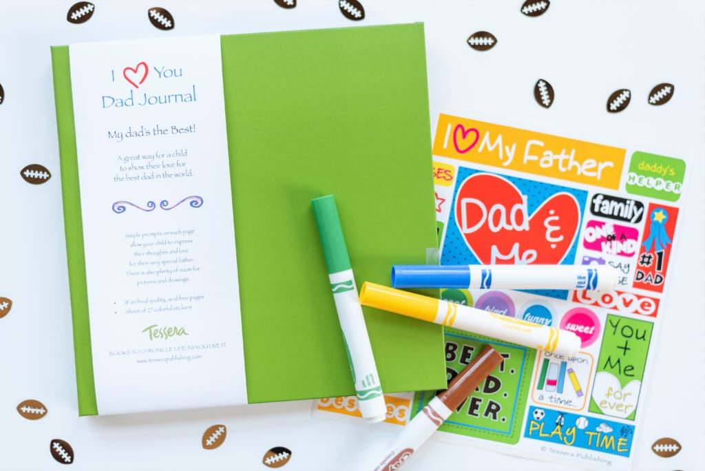 Green I Love You Dad Kids Journal styled with football confetti, sticker sheet, and markers