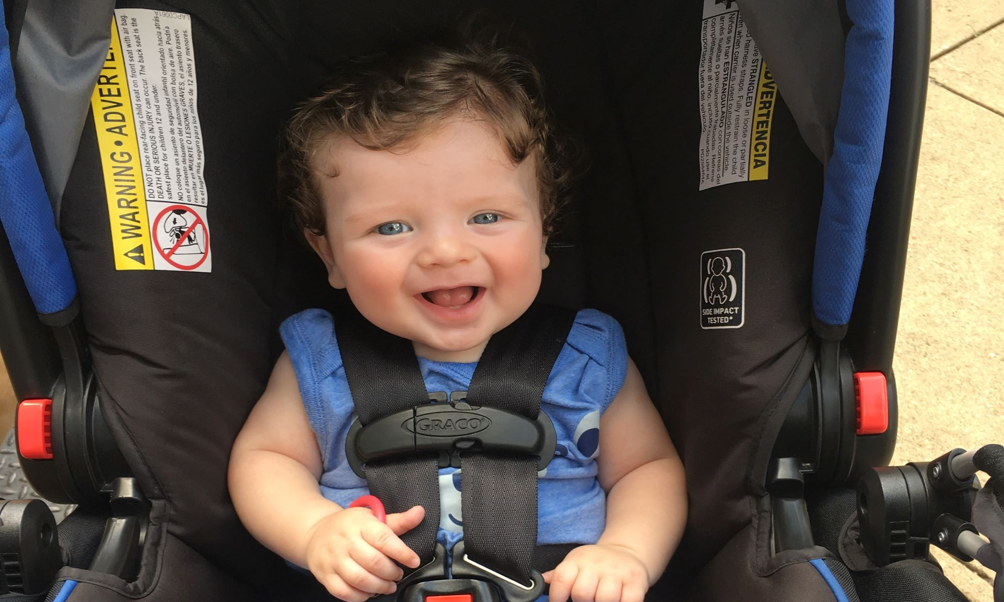 Smiling Baby in Car Seat on Road Trip