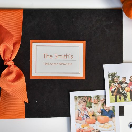 Black paper halloween memory book with orange grosgrain bow and plaque